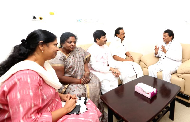 Union Commerce and Industry Minister Suresh Prabhu and BJP leader Shahnawaz Hussain with DMK leaders M.K. Stalin and Kanimozhi during their visit to the Kauvery Hospital where DMK President ... - Suresh Prabhu