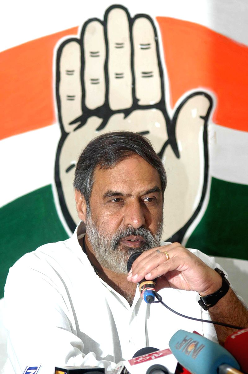 Union Commerce Minister and Congress leader Anand Sharma and West Bengal Congress chief Pradip Bhattacharya during a press conference in Kolkata on April 28, 2014. - Anand Sharma