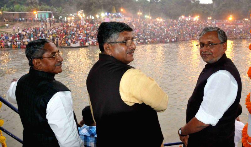 Union Communications and IT Minister Ravi Shankar Prasad and BJP leader Sushil Kumar Modi celebrates Chhath Puja in Patna, on Nov 18, 2015.