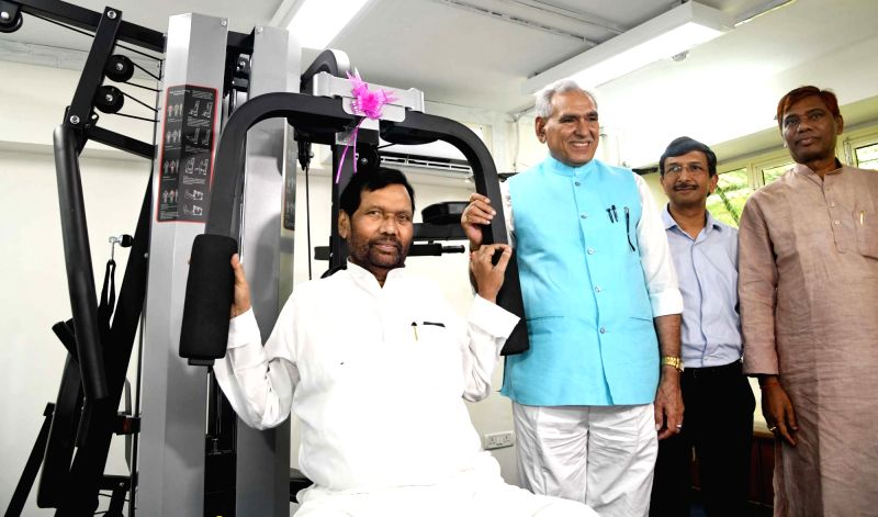 Union Consumer Affairs, Food and Public Distribution Minister Ram Vilas Paswan after the inauguration of Gymnasium of the Department of Food and Public Distribution, in New Delhi on August ... - Ram Vilas Paswan and R. Chaudhary