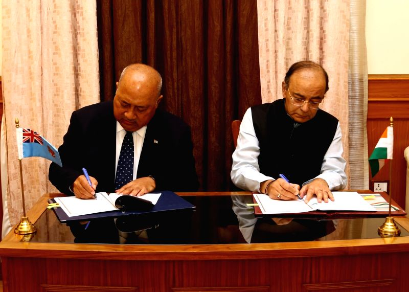 Union Defence Minister Arun Jaitley and Fiji's Minister of Defence and National Security, Ratu Inoke Kubuabola sign MoU to enhance partnership in maritime security in New Delhi on May 219, ... - Arun Jaitley