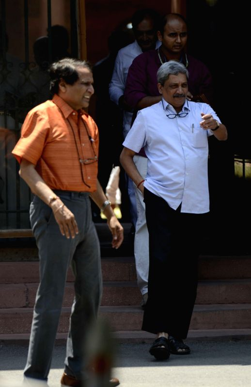 Union Defence Minister Manohar Parrikar and Railway Minister Suresh Prabhakar Prabhu come out after a cabinet meeting at South Block in New Delhi, on May 18, 2016. - Manohar Parrikar and Suresh Prabhakar Prabhu