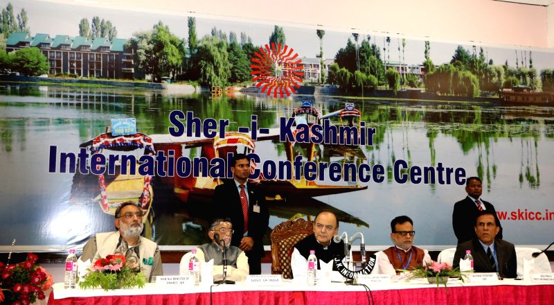 Union Finance Minister Arun Jaitley addresses a press conference after the first day of the GST Council meet.at Sher-e-Kashmir International Convention Centre (SKICC) in Srinagar on May 18, ... - Arun Jaitley