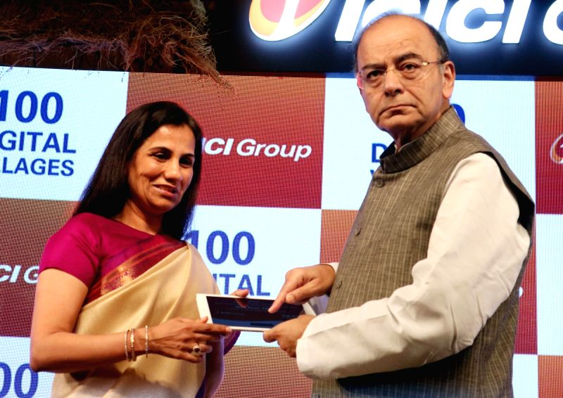 Union Finance Minister Arun Jaitley with Chanda Kochhar, managing director and chief executive officer of ICICI Bank at the inauguration of 100 Digital Villages in New Delhi on May 2, 2017. - Arun Jaitley