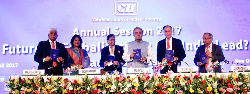 Union Finance Minister Arun Jaitley with CII president Naushad Forbes, CII President Designate Shobana Kamineni  and Vice-Chairman of Bharti Enterprises, Rakesh Bharti Mittal at CII Annual ... - Arun Jaitley