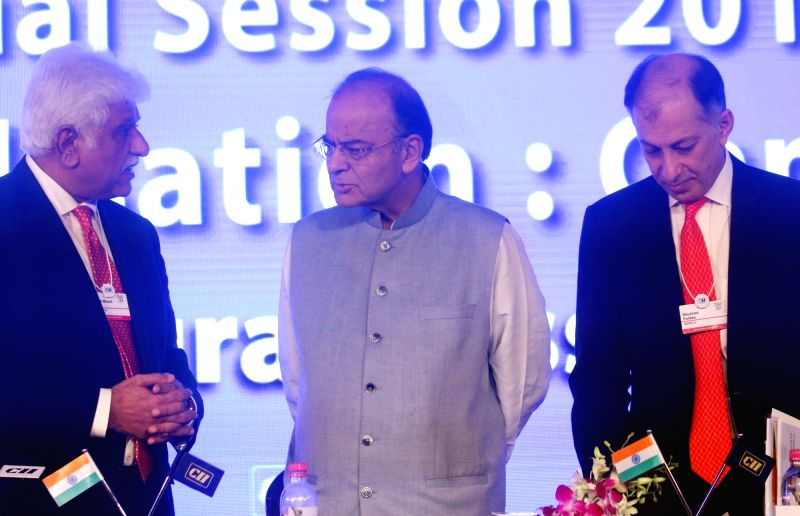 Union Finance Minister Arun Jaitley with CII president Naushad Forbes and Vice-Chairman of Bharti Enterprises, Rakesh Bharti Mittal at CII Annual Session in New Delhi on April 28, 2017. - Arun Jaitley