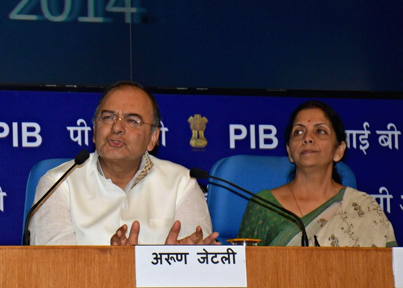 Union Finance Minister, Arun Jaitley with Minister of State for Finance, Nirmala Sitharaman addressing a press conference in New Delhi on Aug. 30, 2014.