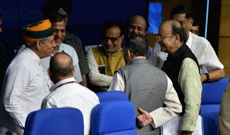 Union Finance Minister Arun Jaitley with Union MoS Finance Arjun Ram Meghwal and Revenue Secretary Hasmukh Adhia during a press conference in New Delhi on June 1, 2017. - Arun Jaitley