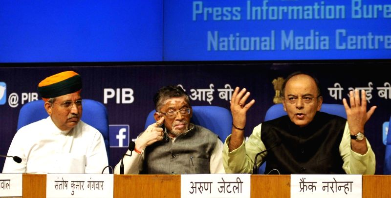 Union Finance Minister Arun Jaitley with Union MoS Finance Arjun Ram Meghwal and Santosh Gangwar during a press conference in New Delhi on June 1, 2017. - Arun Jaitley