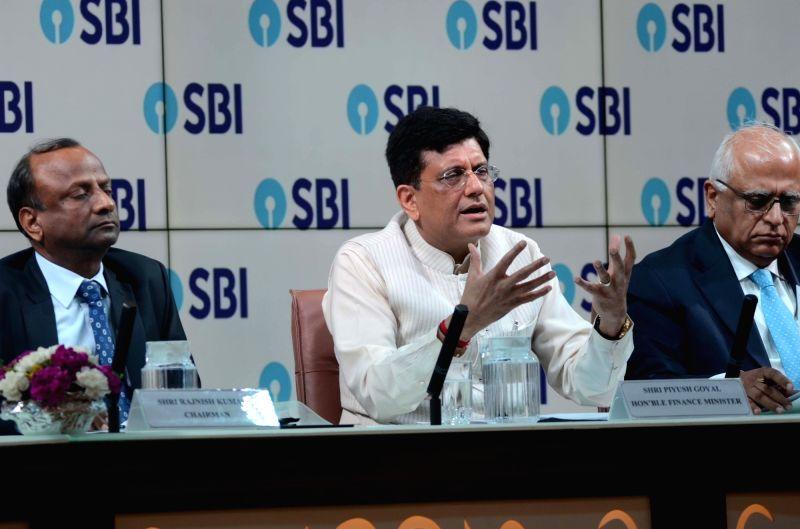 Union Finance Minister Piyush Goyal addresses a press conference at SBI House in Mumbai, on June 8, 2018. - Piyush Goyal