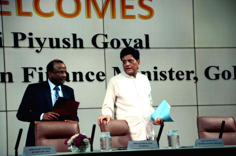 Union Finance Minister Piyush Goyal and SBI Chairman Rajnish Kumar during press conference at SBI House in Mumbai, on June 8, 2018. - Piyush Goyal and Rajnish Kumar