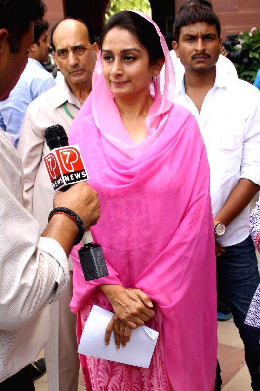 Union Food Processing Minister Harsimrat Kaur Badal talks to media regarding rail budget 2014-15 which was presented in the Parliament by Union Railway Minister D.V. Sadananda Gowda, at Parliament ... - Harsimrat Kaur Badal