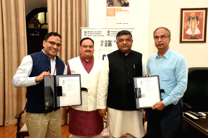 Union Health and Family Welfare Minister J. P. Nadda and Union Electronics and IT and Law and Justice Minister Ravi Shankar Prasad during the signing of an MoU between Common Service ... - J. P. Nadda