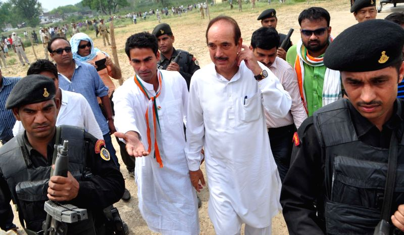 Union Health Minister and Congress leader Ghulam Nabi Azad with party's candidate for 2014 Lok Sabha Election from Phulpur Lok Sabha seat Mohammad Kaif during an election campaign in Phulpur of Uttar