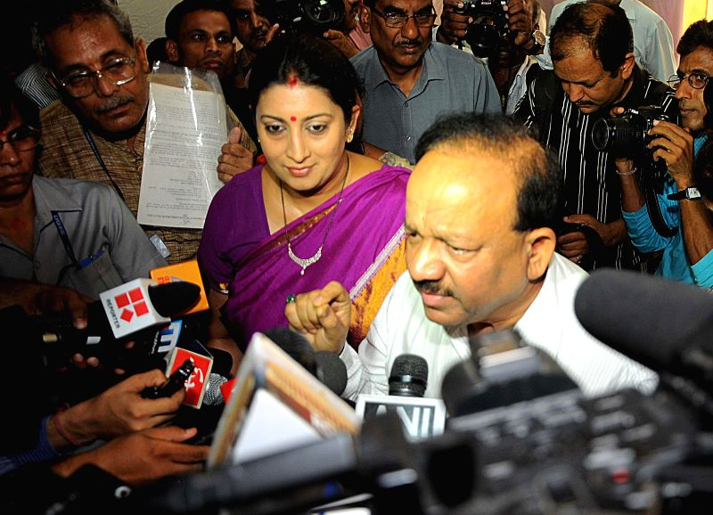 Union Health Minister Dr Harsh Vardhan and Union HRD Minister Smriti Irani interact with press as they arrive to inaugurate `First Aid Post` at Shastri Bhawan  in New Delhi on July 2, 2014. - Smriti Irani