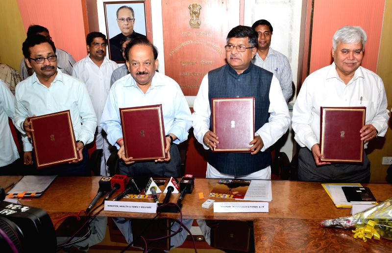 Union Health Minister Harsh Vardhan and Union Minister for Communications and Information Technology, and Law and Justice, Ravi Shankar Prasad sign a Memorandum of Understanding for AIDS awareness ... - Harsh Vardhan