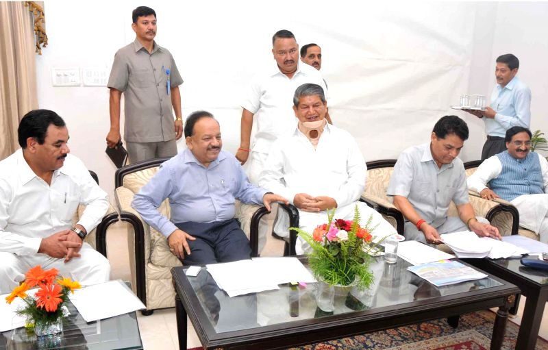 Union Health Minister Harsh Vardhan with Uttarakhand Chief Minister Harish Rawat  in Uttarakhand on July 02, 2014.