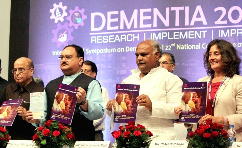 Union Health Minister J.P. Nadda along with Karnataka Health Minister Shivanand S. Patil, former ISRO Chairman K Kasturirangan and Alzheimer's Disease International CEO Paola Barbarino ... - J. and Shivanand S. Patil
