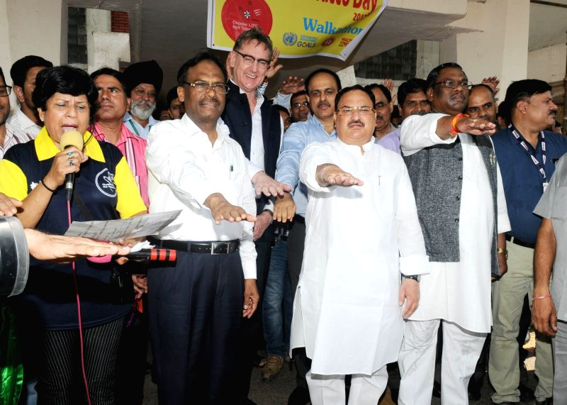 Union Health Minister J.P. Nadda along with Union MoS Health Faggan Singh Kulaste, Director General Health Services Dr. Jagdish Prasad and other dignitaries take pledge on World No Tobacco ... - J. and Faggan Singh Kulaste