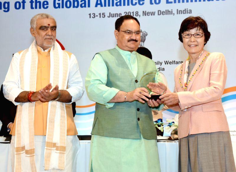 Union Health Minister J.P. Nadda and Union MoS Health Ashwini Kumar Choubey present the GAELF Awards, at the 10th meeting of Global Alliance to Eliminate Lymphatic Filariasis (GAELF), in ... - J. and Ashwini Kumar Choubey