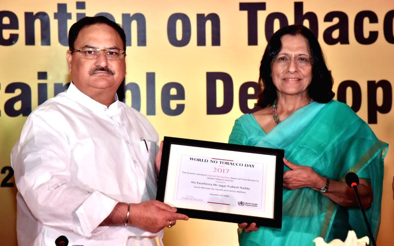 Union Health Minister J.P. Nadda being conferred World Tobacco Award 2017 for his contribution to global tobacco control by WHO-SEARO Regional Director Dr. Poonam Khetrapal Singh in New ... - J. and Poonam Khetrapal Singh