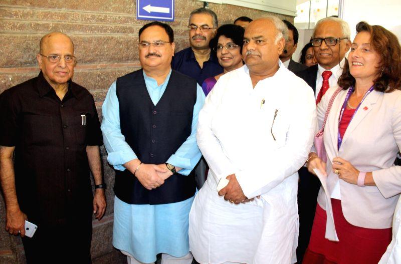 Union Health Minister J.P. Nadda, Karnataka Health Minister Shivanand S. Patil, Former ISRO Chairman K Kasturirangan, Alzheimer's Disease International CEO Paola Barbarino during ... - J. and Shivanand S. Patil