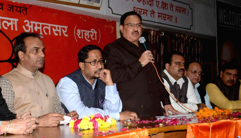 Union Health Minister J P Nadda with BJP leaders during a party programme in Amritsar, on Nov 29, 2015. - J P Nadda