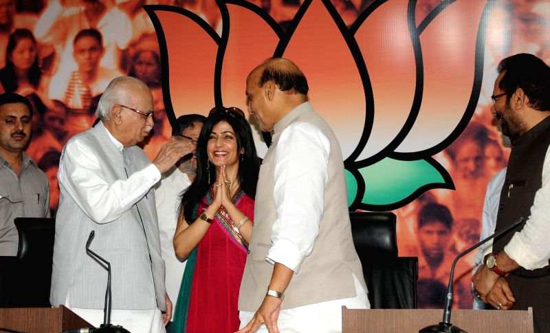 Union Home Minister and BJP chief Rajnath Singh and party veteran L K Advani welcome singer Shibani Kashyap into the party during a programme organised on the birth anniversary of BJP ideologue and .. - Rajnath Singh, L K Advani and Shyama Prasad Mukherjee