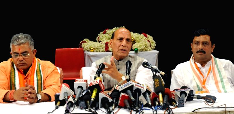 Union Home Minister and BJP leader Rajnath Singh addresses a press conference in Kolkata on April 14, 2017. Also seen BJP leaders Dilip Ghosh and Rahul Sinha. - Rajnath Singh, Dilip Ghosh and Rahul Sinha