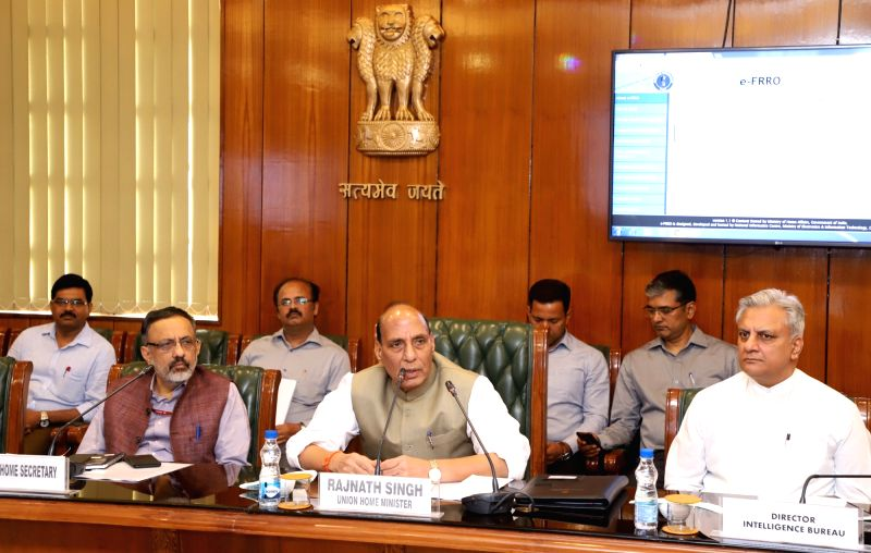 Union Home Minister Rajnath Singh addresses after launching the e-FRRO web portal at a function in New Delhi on April 13, 2018. Also seen Union Home Secretary Rajiv Gauba and the IB ... - Rajnath Singh and Rajiv Jain
