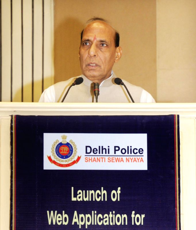 Union Home Minister Rajnath Singh addresses at the launch of Web application of Delhi Police for issuing Police Clearance Certificate, in New Delhi on Aug 8, 2014.