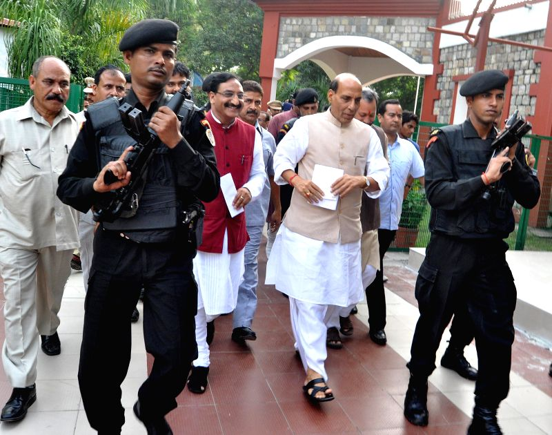 Union Home Minister Rajnath Singh and BJP leader and former chief minister Ramesh Pokhriyal Nishank at Bijapur guest house in Dehradun on Aug 17, 2014.