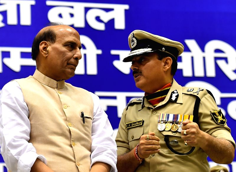 Union Home Minister Rajnath Singh and BSF DG Krishan Kumar Sharma during 14th BSF Investiture Ceremony in New Delhi, on May 20, 2016. - Rajnath Singh and Krishan Kumar Sharma