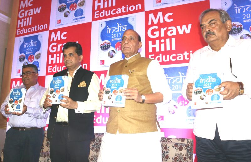 "Union Home Minister Rajnath Singh and NITI Aayog CEO Amitabh Kant with McGraw-Hill Education Managing Director Kaushik Bellani at the launch of  ""India 2017 Yearbooks"" in New ... - Rajnath Singh"