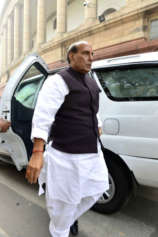 Union Home Minister Rajnath Singh arrives at the Parliament in New Delhi on Nov 30, 2015. - Rajnath Singh