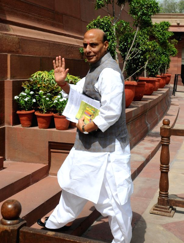 Union Home Minister Rajnath Singh arrives to attend the budget session of the Parliament in New Delhi on July 7, 2014. - Rajnath Singh