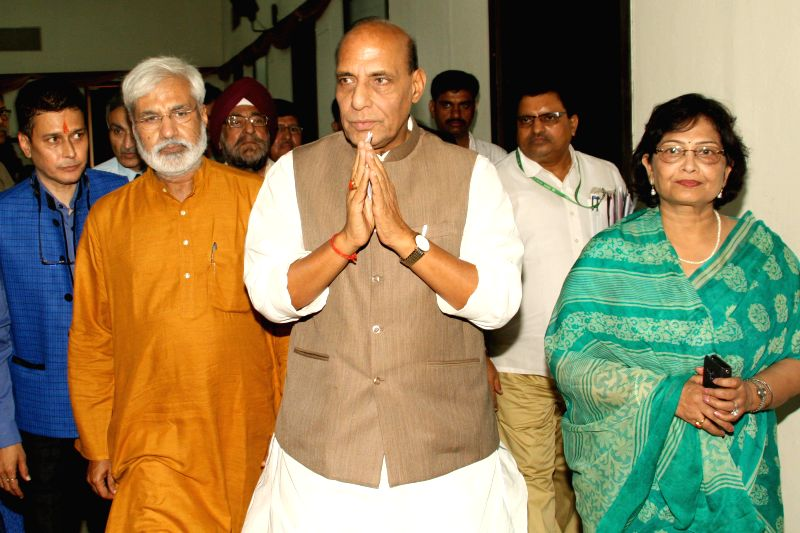 Union Home Minister Rajnath Singh at a seminar organised in the memory of journalist Udyan Sharma in New Delhi on July 11, 2014. Also seen veteran journalist Rahul Dev and others. - Rajnath Singh, Udyan Sharma and Rahul Dev