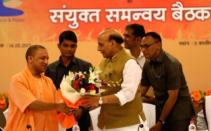 Union Home Minister Rajnath Singh being felicitated by Uttar Pradesh Chief Minister Yogi Adityanath during a meeting regarding International Yoga Day in Lucknow on May 14, 2017. - Rajnath Singh