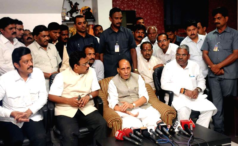 Union Home Minister Rajnath Singh briefs media after visiting the landslide site at Maalin village; in Pune on July 31, 2014. - Rajnath Singh