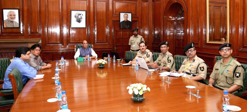 Union Home Minister Rajnath Singh chairs a preparatory meeting ahead of the launch of MHA mobile app on grievance redressal for CAPF personnel in New Delhi on April 28, 2017. BSF DG KK ... - Rajnath Singh