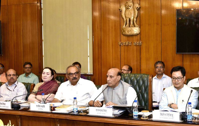 Union Home Minister Rajnath Singh chairs a meeting of the Hindi Advisory Committee of the Ministry of Home Affairs, in New Delhi on June 02, 2017. Union MoS Home Affairs Kiren Rijiju is ... - Rajnath Singh