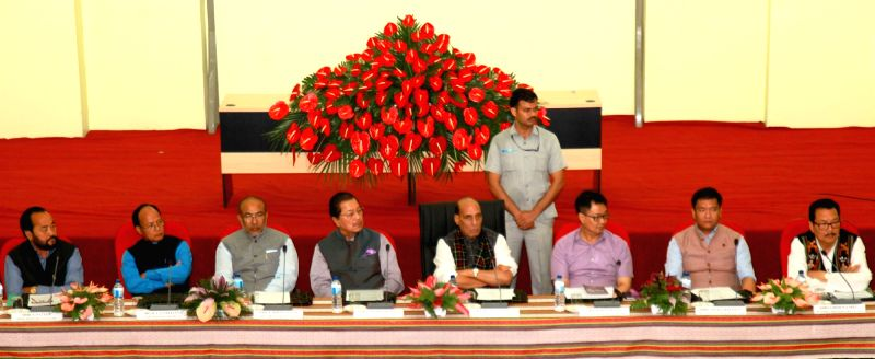Union Home Minister Rajnath Singh chairs a review meeting on Indo-Myanmar border issues in Aizawl, Mizoram on June 12, 2017. Also seen Mizoram Chief Minister Pu Lalthanhawla, Manipur Chief ... - Rajnath Singh and N Biren Singh