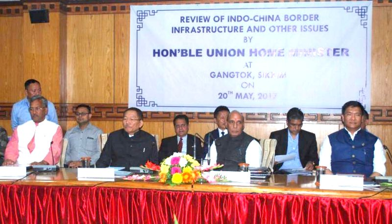 Union Home Minister Rajnath Singh chairs first security review meeting with Chief Ministers of five states bordering China; in Gangtok, Sikkim on May 20, 2017. Also seen Arunachal Pradesh ... - Rajnath Singh, Pawan Kumar Chamling and Trivendra Singh Rawat
