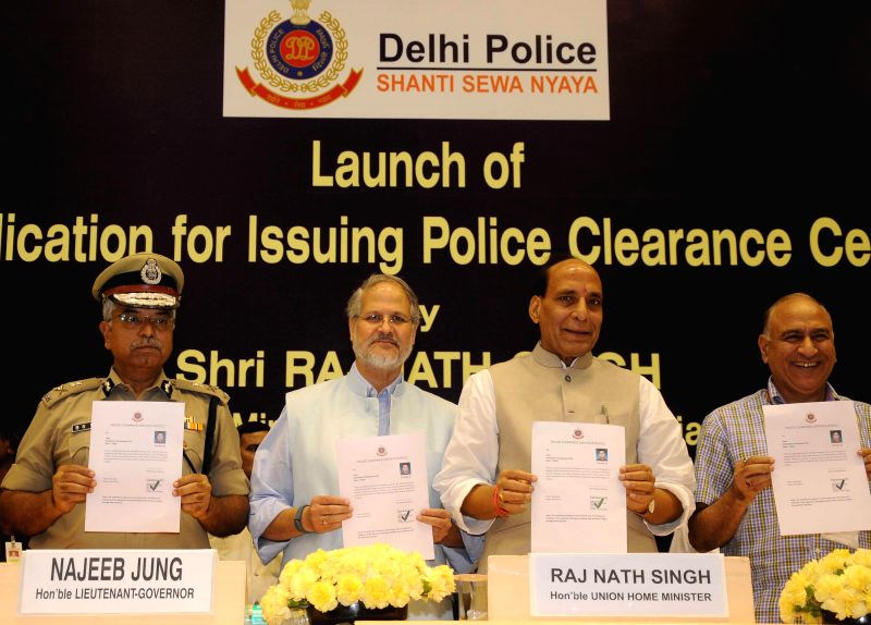 Union Home Minister Rajnath Singh, Delhi Lt Governor Najeeb Jung and Delhi Police Commissioner BS Bassi at the launch of a Web application of Delhi Police for issuing Police Clearance Certificate, in