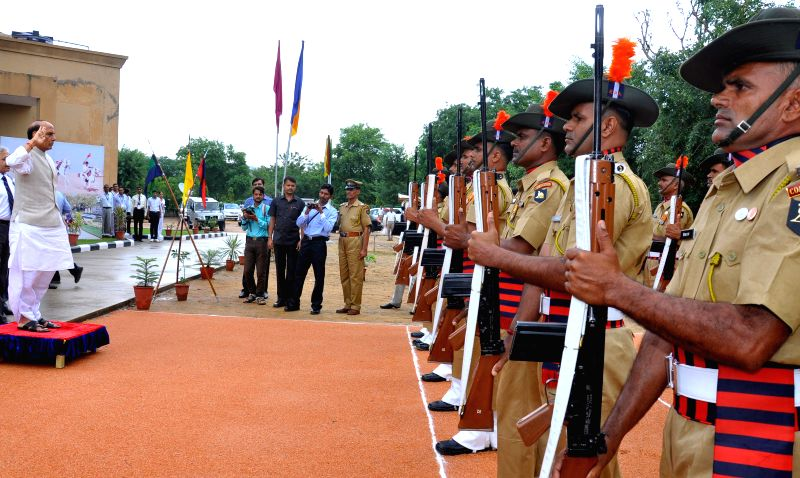 Union Home Minister Rajnath Singh inspects guard of honour at the 33rd National Symposium of Heads of Police Training Institution, Rajasthan Police Academy in Jaipur on Sept 3, 2014.