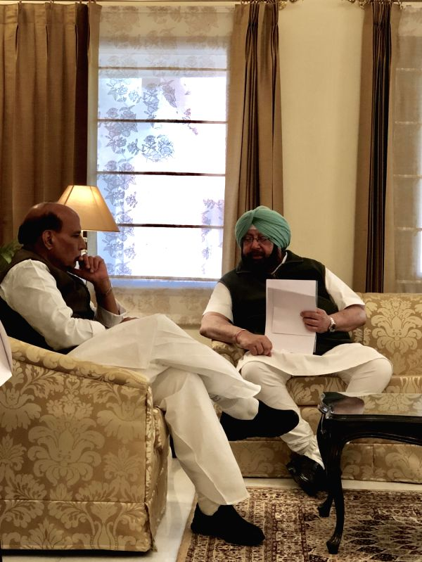 Union Home Minister Rajnath Singh interacts with Punjab Chief Minister Captain Amarinder Singh in Chandigarh on Jan 30, 2018. - Rajnath Singh and Amarinder Singh