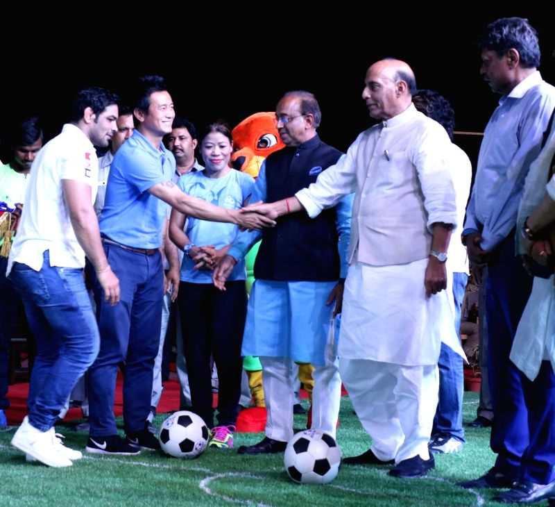 "Union Home Minister Rajnath Singh kick off ""OORJA"" by CAPF U-19 Football talent hunt tournament 2017 for boys and girls at the backdrop of India Gate in New Delhi on April 22, ... - Rajnath Singh, Kapil Dev and Sushil Kumar"