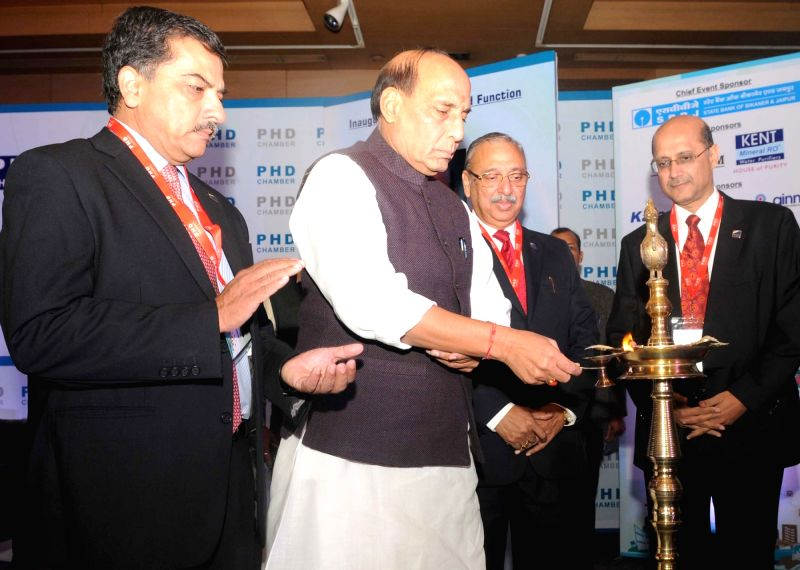 Union Home Minister Rajnath Singh lighting the lamp to inaugurate the 110th Annual Session of the PHD Chamber and PHD Annual Awards for Excellence – 2015 function, in New Delhi on ... - Rajnath Singh