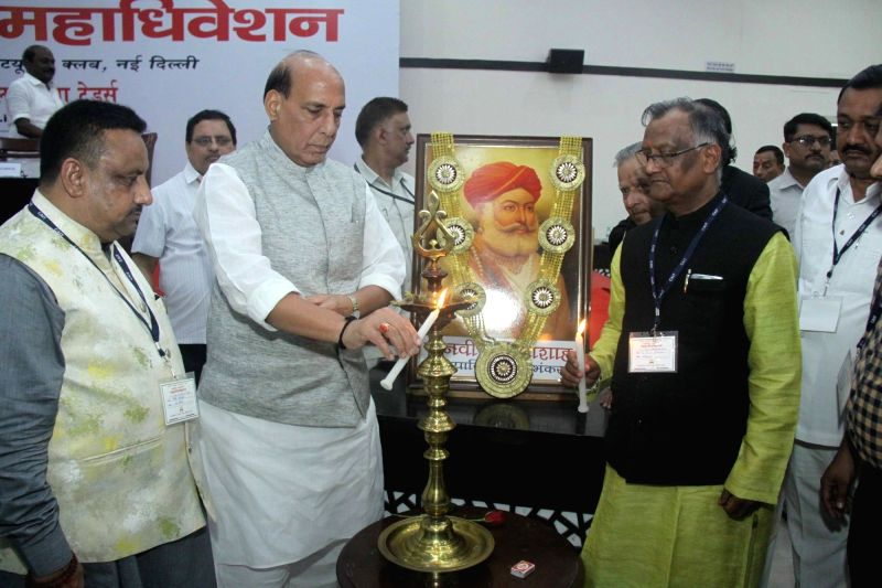 Union Home Minister Rajnath Singh lights the lamp to inaugurate​ the​ three-day ​​National Traders​'​ Conclave, in New Delhi on ​July 23, 2018​. - Rajnath Singh