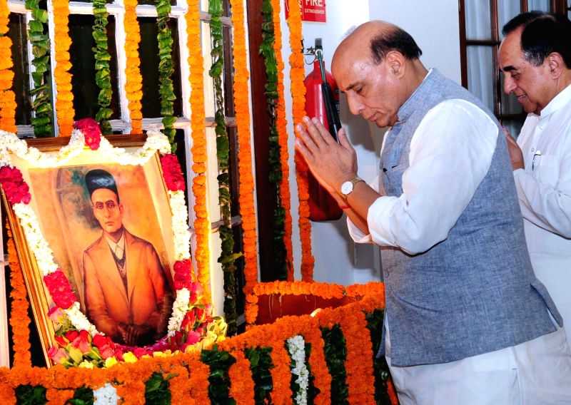 Union Home Minister Rajnath Singh pays homage to Swatantryaveer Vinayak Damodar Savarkar, on his birth anniversary, at Parliament House, in New Delhi on May 28, 2016. - Rajnath Singh